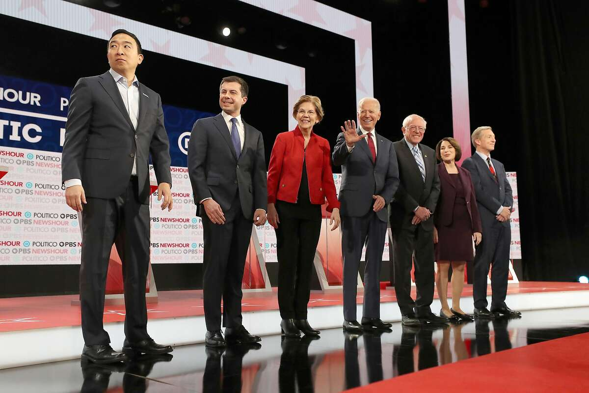 LOS ANGELES, CALIFORNIA - DECEMBER 19: Democratic presidential candidates (L-R) Andrew Yang, South Bend, Indiana Mayor Pete Buttigieg, Sen. Elizabeth Warren (D-MA), Former Vice President Joe Biden, Sen. Bernie Sanders (I-VT), Sen. Amy Klobuchar (D-MN), and Tom Steyer await the start of the Democratic presidential primary debate at Loyola Marymount University on December 19, 2019 in Los Angeles, California. Seven candidates out of the crowded field qualified for the 6th and last Democratic presidential primary debate of 2019 hosted by PBS NewsHour and Politico. (Photo by Mario Tama/Getty Images)