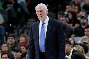 San Antonio Spurs coach Gregg Popovich watches play during the first half of the team's NBA basketball game against the Brooklyn Nets, Thursday, Dec. 19, 2019, in San Antonio. (AP Photo/Darren Abate)
