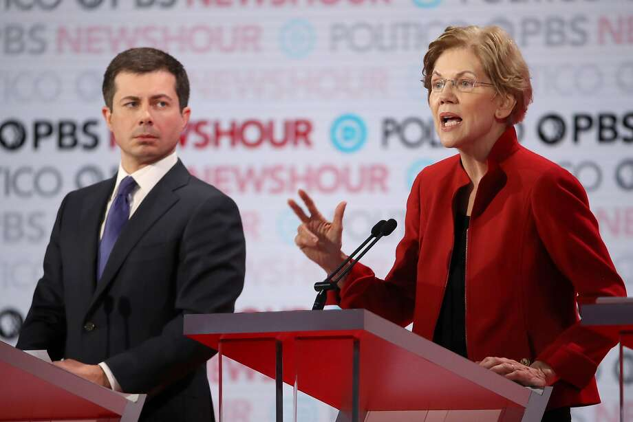Sen. Elizabeth Warren (D-MA) speaks as South Bend, Indiana Mayor Pete Buttigieg listens during the Democratic presidential primary debate at Loyola Marymount University on December 19, 2019 in Los Angeles, California. Seven candidates out of the crowded field qualified for the 6th and last Democratic presidential primary debate of 2019 hosted by PBS NewsHour and Politico. Photo: Justin Sullivan, Getty Images