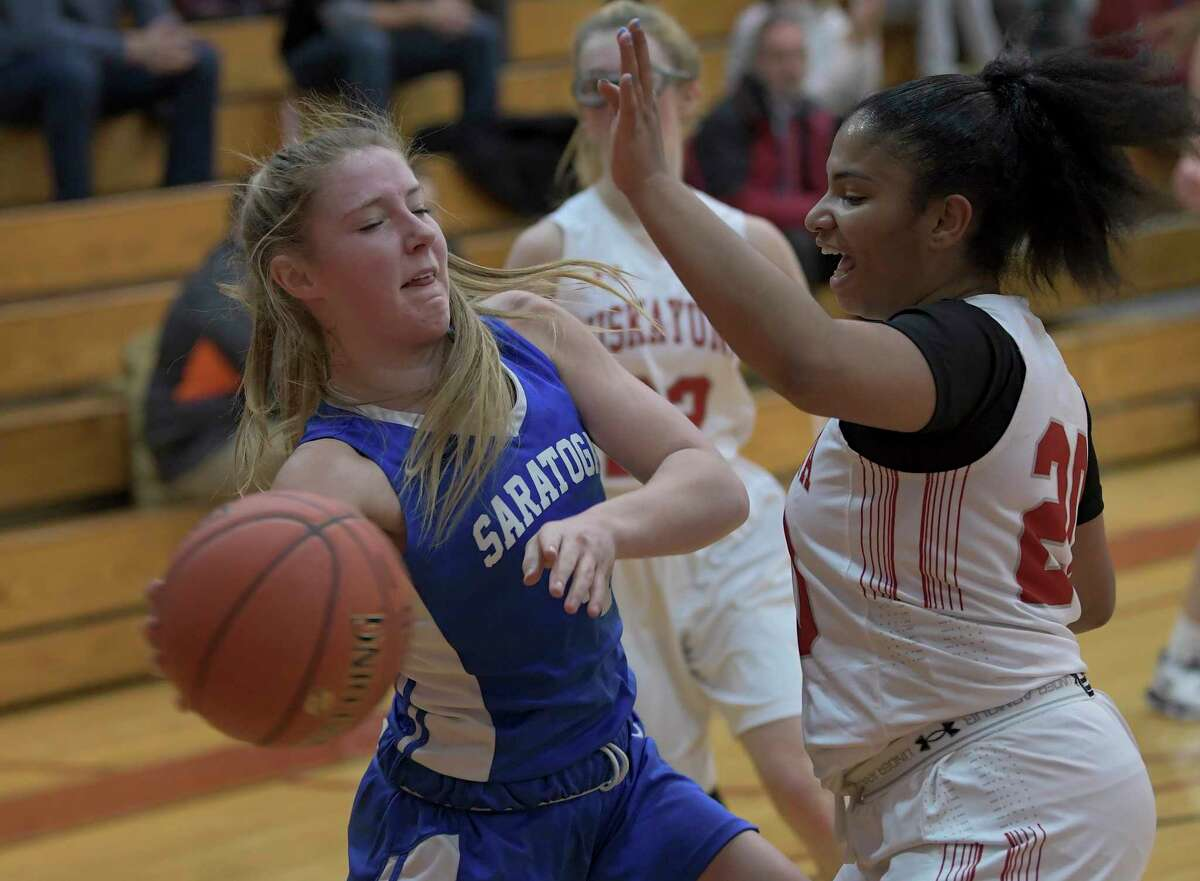 Saratoga's Abby Ray (4) moves the ball against Niskayuna's Ivian Owens (20) during the first half of a Section II girls' basketball game Thursday, Dec. 19, 2019, in Niskayuna, N.Y. (Hans Pennink / Special to the Times Union) ORG XMIT: 122019_hsbb_HP101