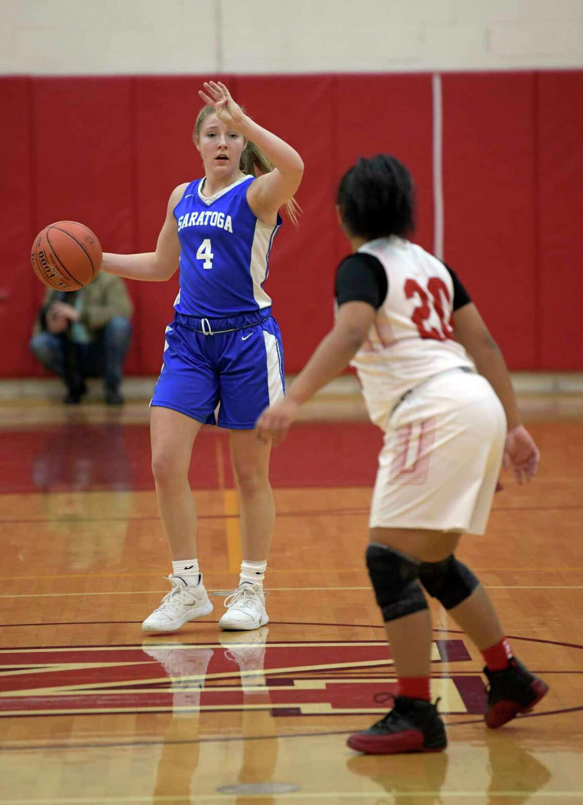 Saratoga's Abby Ray (4) moves the ball against Niskayuna's Ivian Owens (20) during the first half of a Section II girls' basketball game Thursday, Dec. 19, 2019, in Niskayuna, N.Y. (Hans Pennink / Special to the Times Union) ORG XMIT: 122019_hsbb_HP102