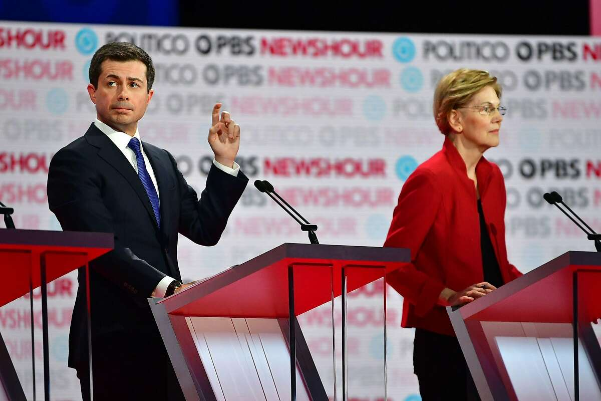 Democratic presidential hopeful Mayor of South Bend, Indiana Pete Buttigieg (L) and Massachusetts Senator Elizabeth Warren participate of the sixth Democratic primary debate of the 2020 presidential campaign season co-hosted by PBS NewsHour & Politico at Loyola Marymount University in Los Angeles, California on December 19, 2019. (Photo by Frederic J. Brown / AFP) (Photo by FREDERIC J. BROWN/AFP via Getty Images)