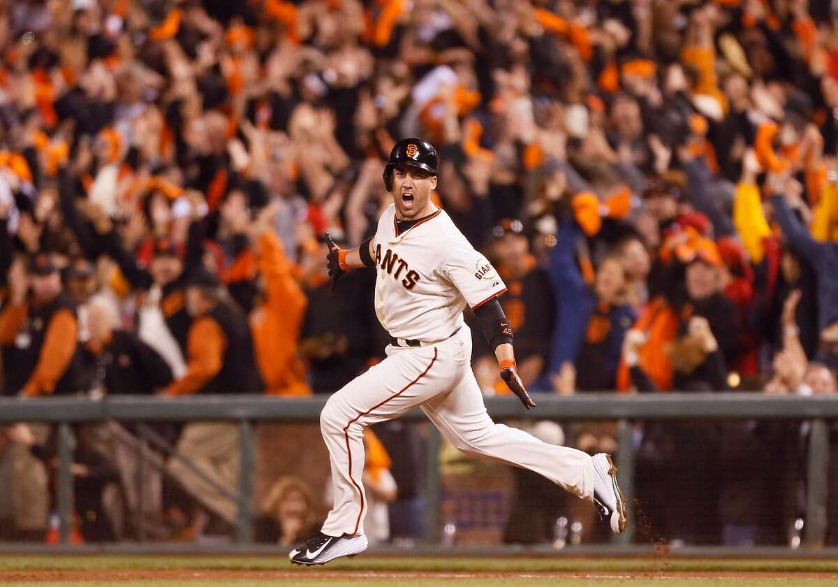 Giants Travis Ishikawa rounds the bases after hitting a three-run homer to defeat the St. Louis Cardinals 6 to 3 sending the Giants to the World Series during Game 5 of the NLCS at AT&T Park on Thursday, Oct. 16, 2014 in San Francisco, Calif.
