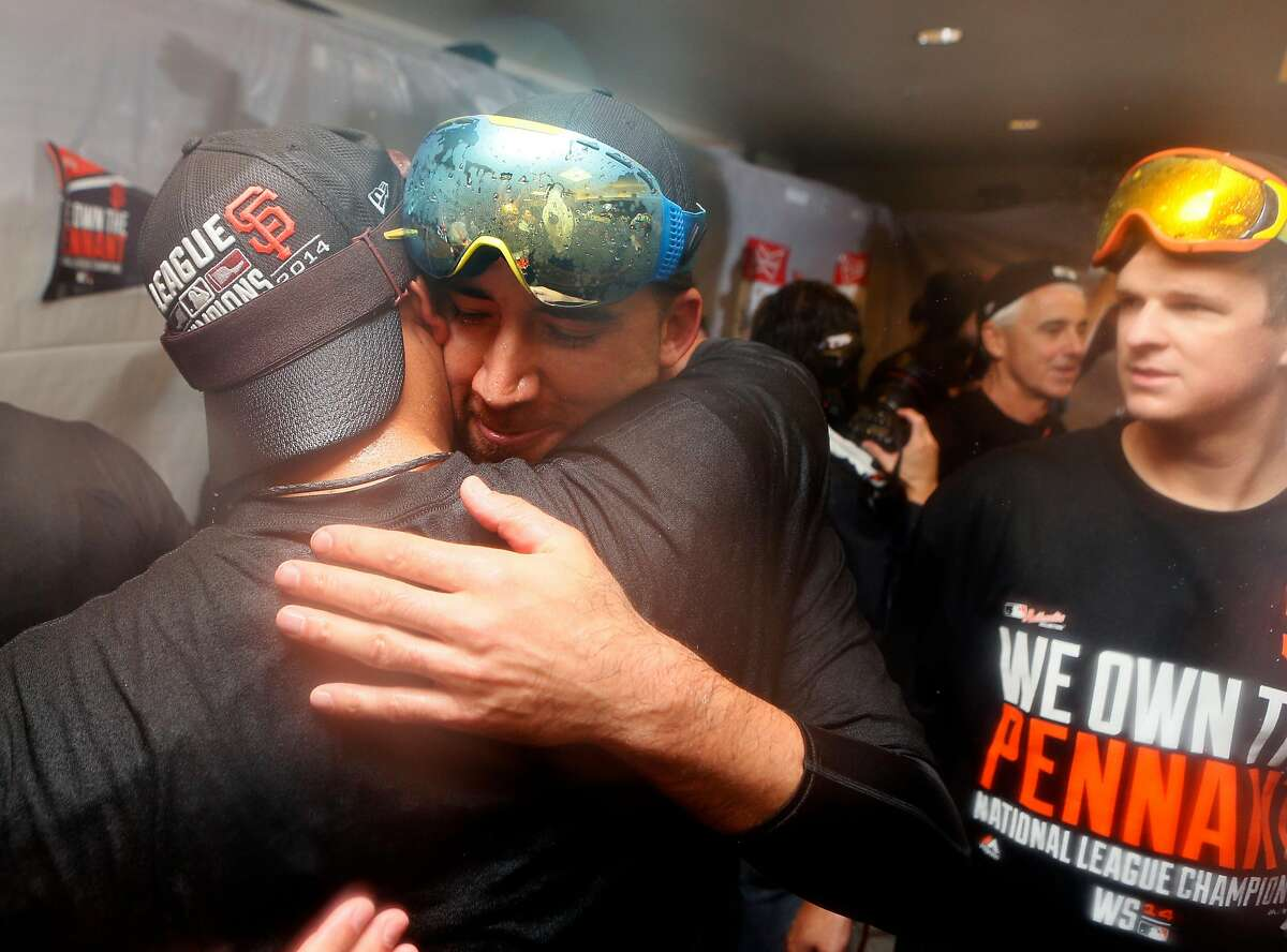 Giants Travis Ishikawa gets a hug in the Giants clubhouse after Game 5 of the NLCS at AT&T Park on Thursday, Oct. 16, 2014 in San Francisco, Calif.
