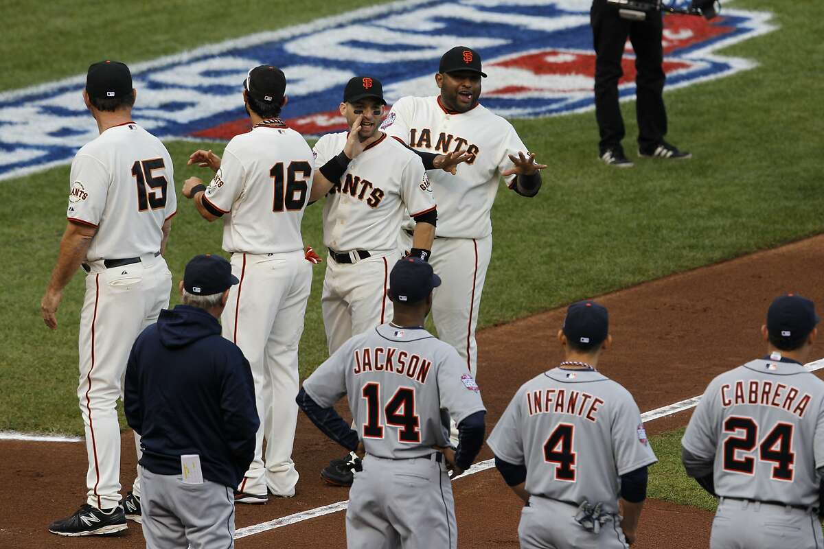Giants' 2nd baseman Marco Scutaro and Giants' 3rd baseman Pablo Sandoval gesture to the Detroit Tigers' lineup prior to the World Series game 1 at AT&T Park in San Francisco, Calif., on Wednesday, Oct. 24, 2012.