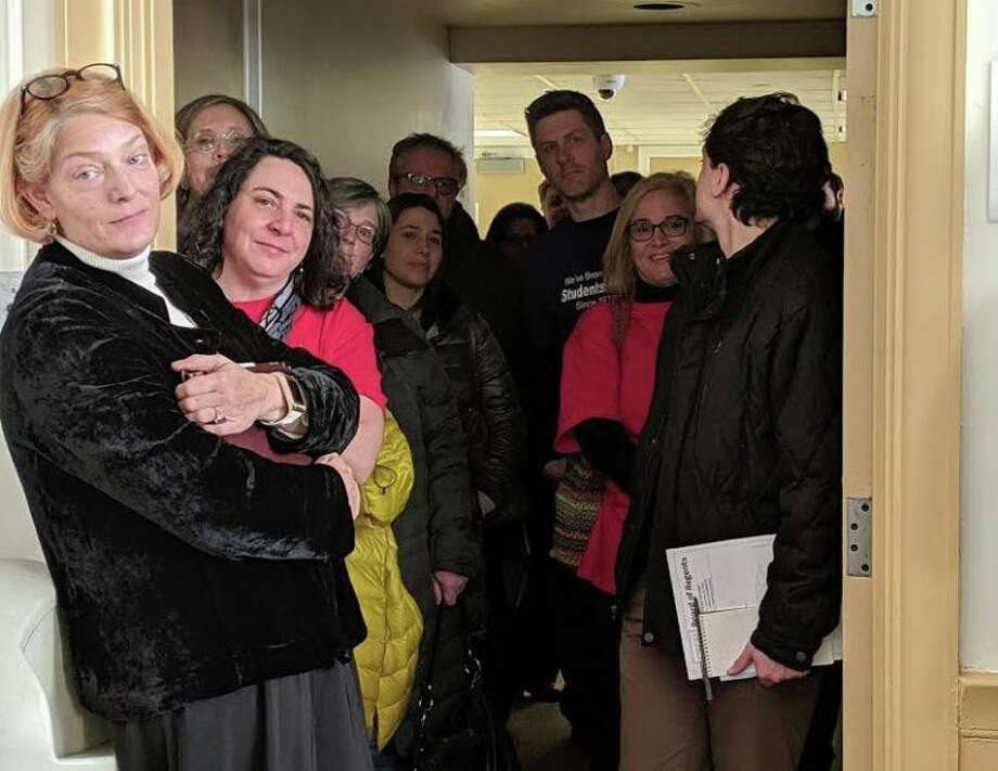 Dozens of faculty had to remain out in the hall at Thursday's board meeting because there wasn't enough space in the board room. Photo: Kathleen Megan / CTMirror.org