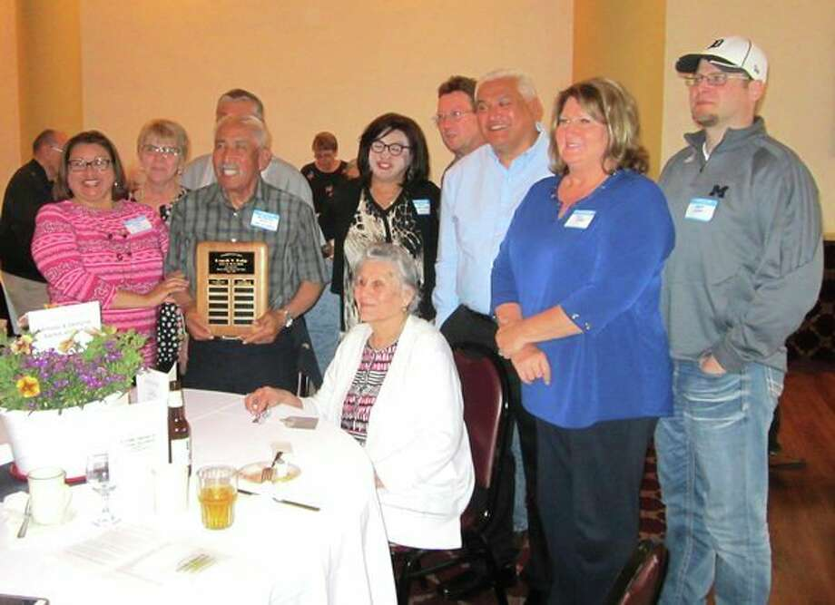 Alfredo Santos, Sr. is pictured with his wife, Georgina, and their family at the ceremony where he received the Loyal to Labor award. (Submitted Photo)