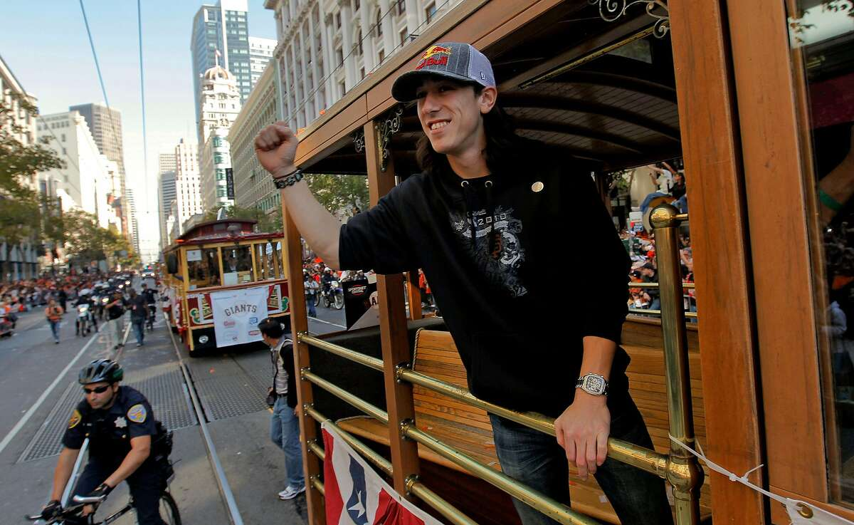 Giants' Tim Lincecum waves to fans along Market Street, as the City of San Francisco celebrates the World Series Champion Giants with a parade down Market Street, on Wednesday Nov. 3, 2010 in San Francisco, Calif.