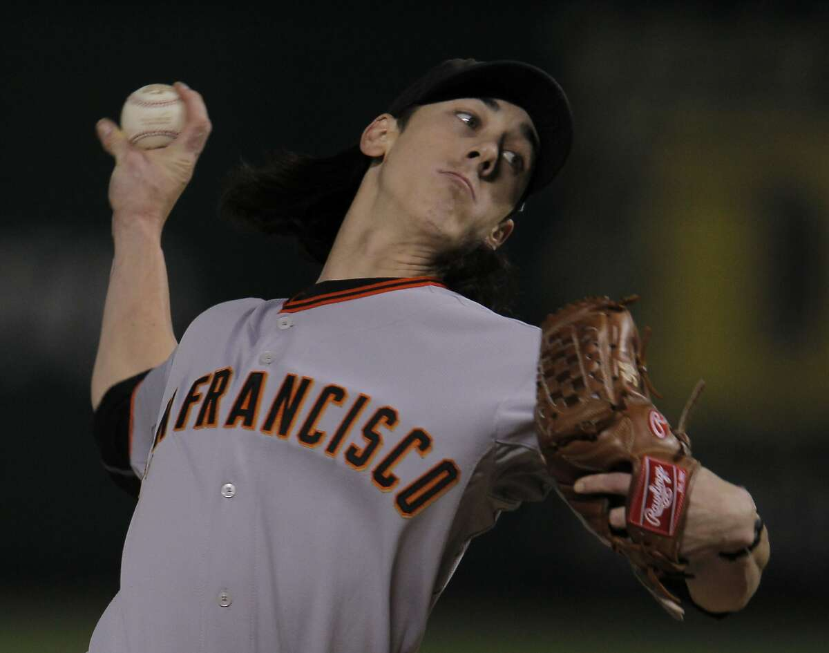 San Francisco Giants starting pitcher Tim Lincecum (55) delivers a pitch in the fist inning during game 5 of the 2010 World Series between the San Francisco Giants and the Texas Rangers on Monday, Nov. 1, 2010 in Arlington, Tx.
