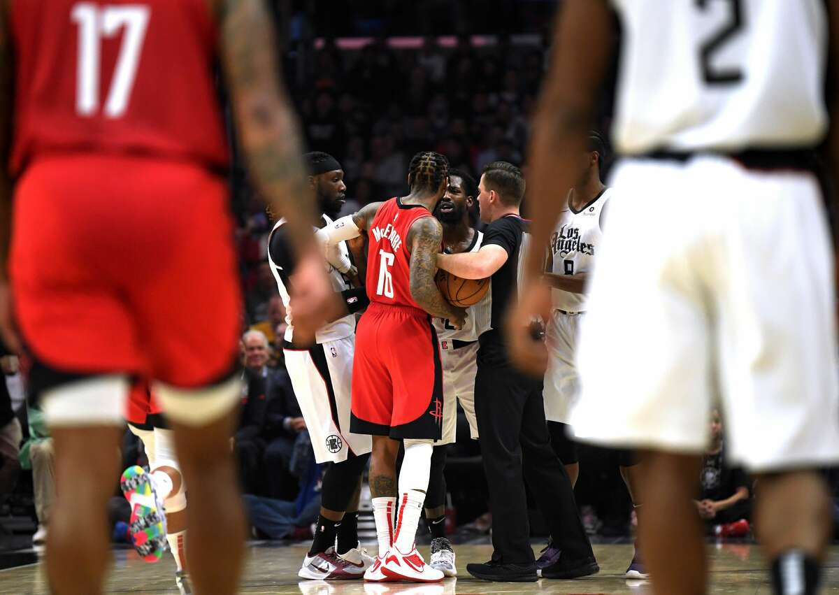 LOS ANGELES, CALIFORNIA - DECEMBER 19: Ben McLemore #16 of the Houston Rockets and Patrick Beverley #21 of the LA Clippers argue on the court during the first half of the game at Staples Center on December 19, 2019 in Los Angeles, California. (Photo by Harry How/Getty Images)