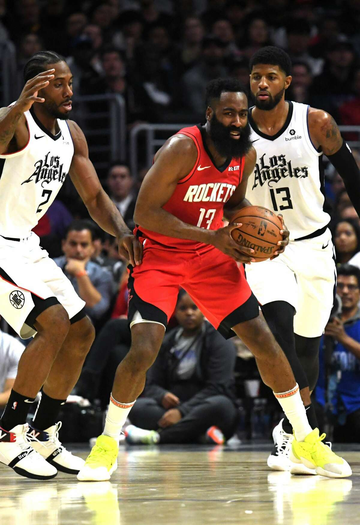LOS ANGELES, CALIFORNIA - DECEMBER 19: James Harden #13 of the Houston Rockets is guarded by Kawhi Leonard #2 and Paul George #13 of the LA Clippers during the first half of the game at Staples Center on December 19, 2019 in Los Angeles, California. (Photo by Harry How/Getty Images)