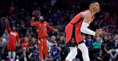 Russell Westbrook #0 of the Houston Rockets reacts to his pass leading to a three pointer, to take a 90-87 lead, during the third quarter in a 122-117 Rockets win at Staples Center on December 19, 2019 in Los Angeles, California. (Photo by Harry How/Getty Images)