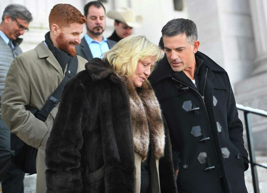 Fotis Dulos exits the Connecticut State Supreme Court with his sister, Rena Dulos, after attending arguments by his attorney to strike down the gag order imposed in his case in Hartford, Conn. on Thursday, December 12, 2019. Photo: Brian A. Pounds / Hearst Connecticut Media / Connecticut Post