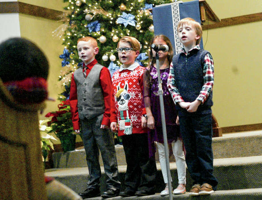 "First- and second-graders perform the hymn ""O Little Town of Bethlehem"" during Salem Lutheran Church and School's children's Christmas service Thursday."