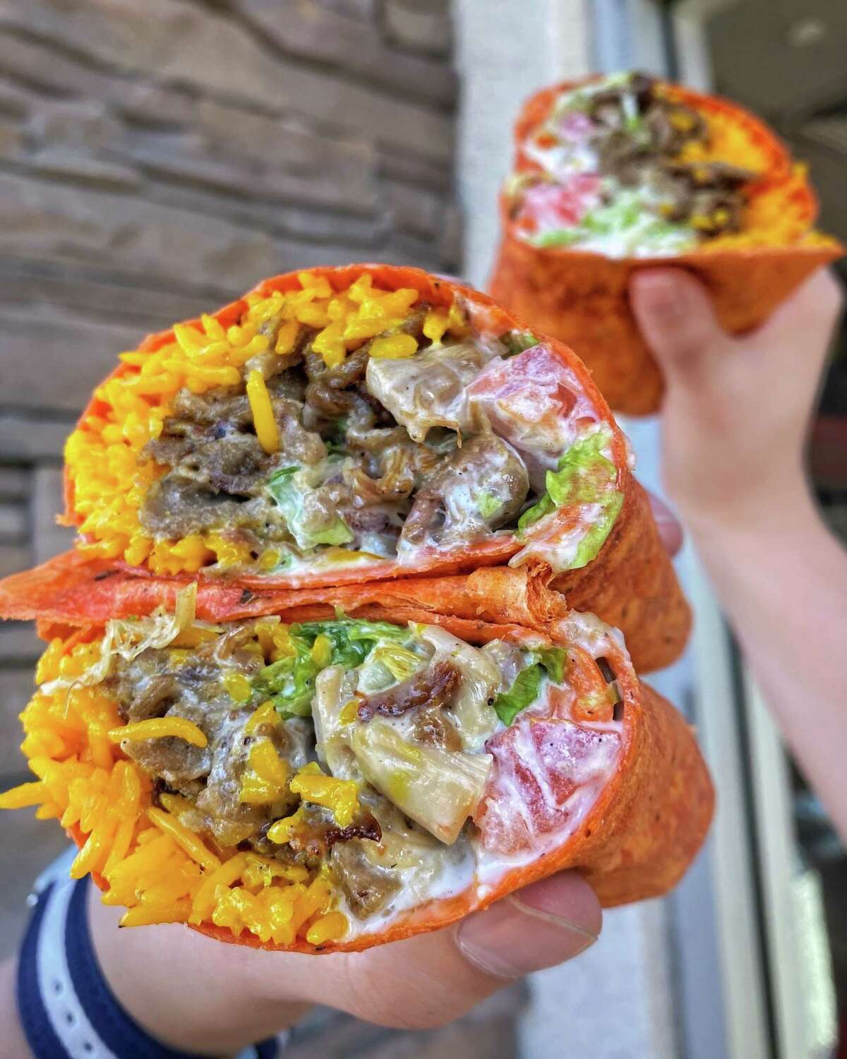 The Halal Guys is offering a new burrito stuffed with a variety of fillings, a cheese white sauce and built with a sundried tomato tortilla.