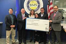 """Left, Bedford seventh-grader Sofia Alarcon-Frias is the middle school division grand prize winner in the 2019 Altice USA Hispanic Heritage Month Essay Contest for her piece titled """"An Unstoppable Dreamer."""""""