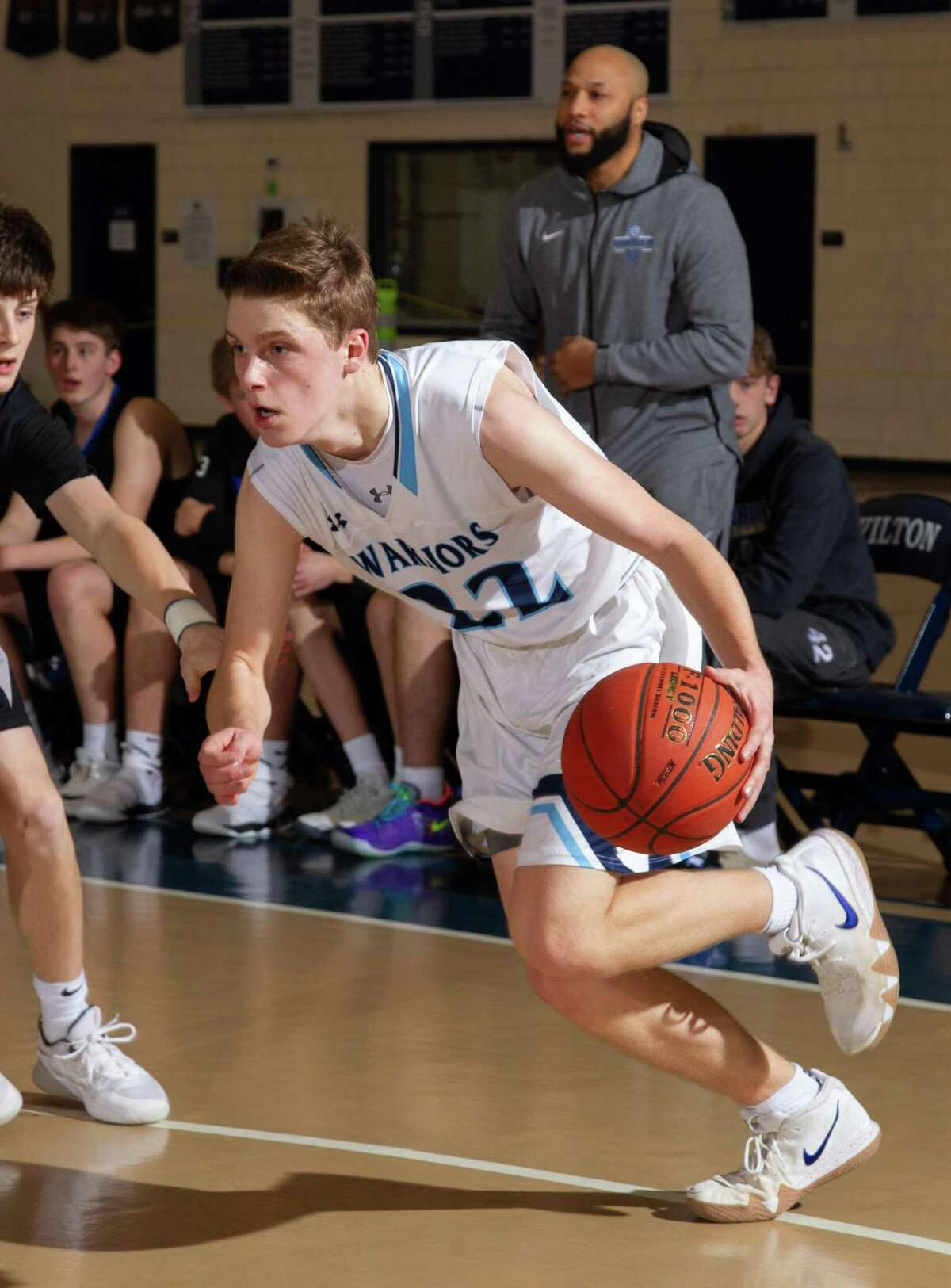 Andrew Smith (file photo) scored 18 points in Wilton's season-ending loss to New Britain on Monday night in the Division I state tournament.