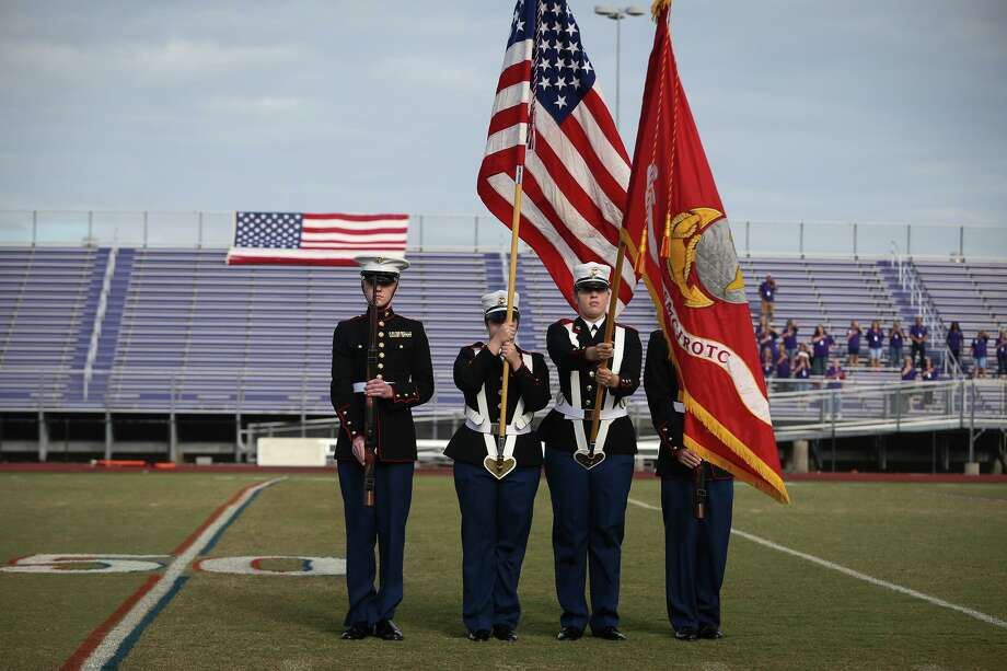 Montgomery Marine JROTC honor guard presents the colors for the national anthem during the Veterans Day Celebration on Tuesday, Nov. 1, 2016, at Bears Stadium in Montgomery. Photo: Michael Minasi, Staff / Chronicle / © 2016 Houston Chronicle