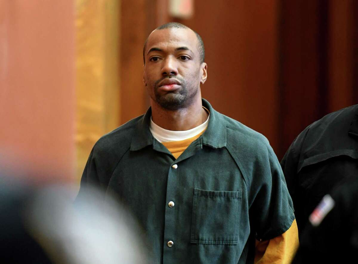 Antwaun Twitty is one of three defendants who were reindicted on second-degree murder charges related to the 2019 homicide of Beyonce Wint in the Lansingburgh section of Troy, N.Y. He is seen in this Dec. 20, 2019 photo being escorted to Judge Andrew Ceresia's courtroom in the Rensselaer County Court House after his first arraignment for second-degree murder in the case. (Will Waldron/Times Union)