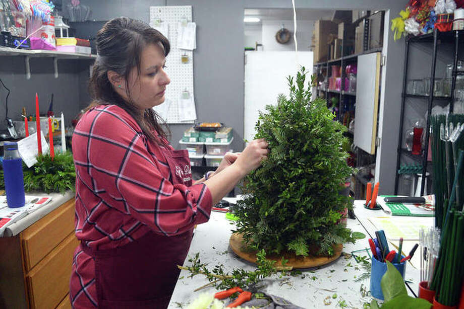 Rachel Clothier, owner of Goff & Dittman Florists in Edwardsville, creates a boxwood tree. Photo: Scott Marion|The Intelligencer