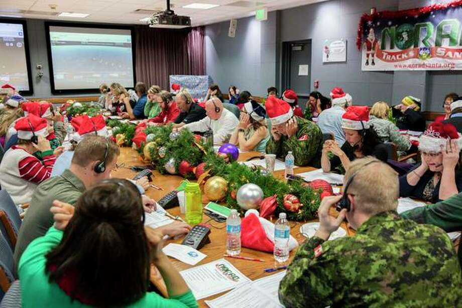 Volunteers man the phone at NORAD headquarters each Christmas Eve to field the questions of boys and girls tracking the journey of Santa Claus. Photo: Photo Contributed By NORAD / / Public Domain