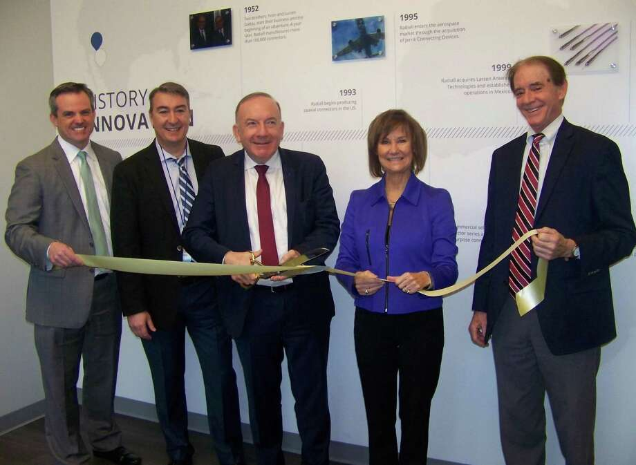 From left, Garrett Sheehan, president and CEO of the Quinnipiac & Greater New Haven Chambers of Commerce; Patrice Rigoland, Ph.D., general manager of Radiall; Pierre Gattaz, Radiall president and chairman; Quinnipiac Chamber of Commerce Executive Director Dee Prior-Nesti; and Wallingford Mayor William Dickinson at the grand opening of Radiall USA Inc. at 777 Northrop Road recently. Radiall USA provides components to customers in the aerospace, defense, industrial, medical, telecom and space industries. For more information, call 203-776-2813 or visit www.radiall.com. Photo: Contributed Photo