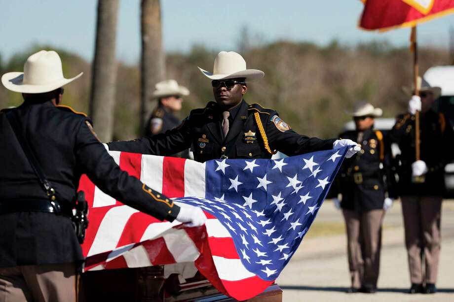 Members of the Harris County Sheriff's Office Honor Guard lift the United States flag from the casket of Nassau Bay Police Department Sgt. Kaila Sullivan, a Friendswood resident who died in December after being struck in a traffic stop. Photo: Marie D. De Jesús, Houston Chronicle / Staff Photographer / © 2019 Houston Chronicle