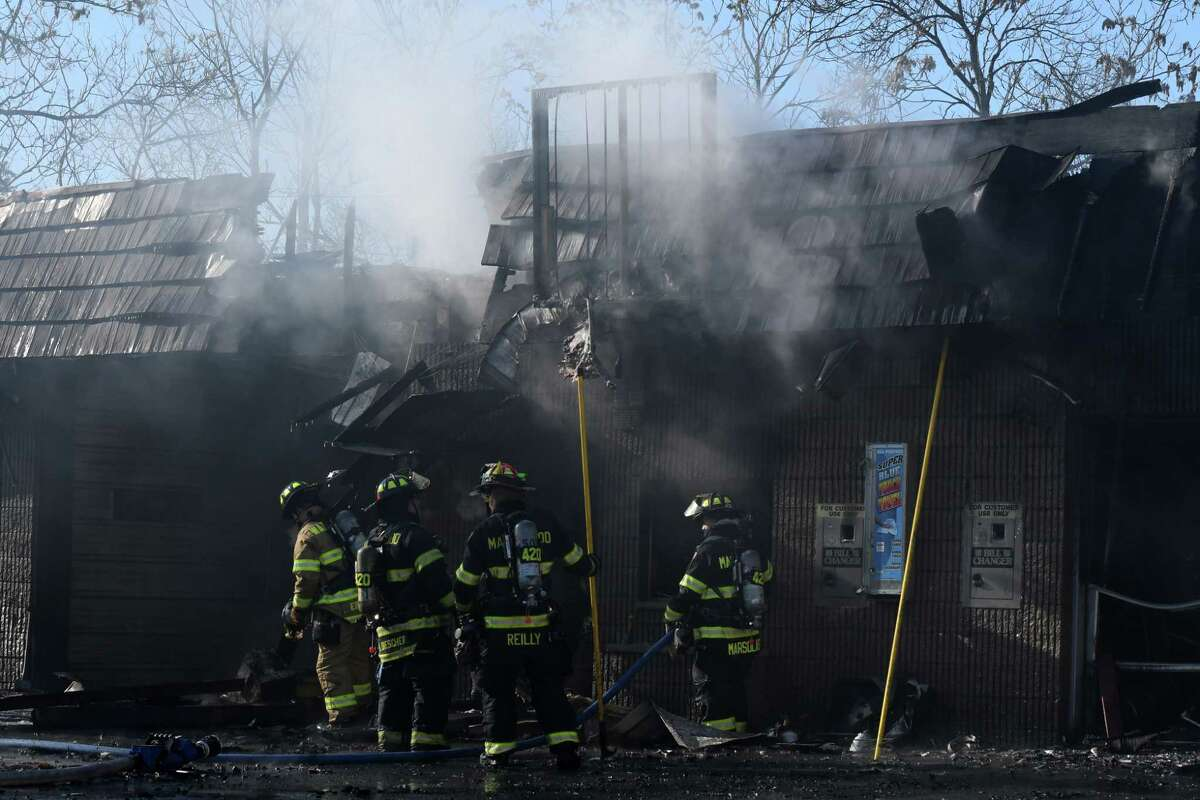 Firefighters respond to a blaze at Tom & Jerry's Car Wash on Friday, Dec. 20, 2019, on Second Avenue in Colonie, N.Y. (Will Waldron/Times Union)