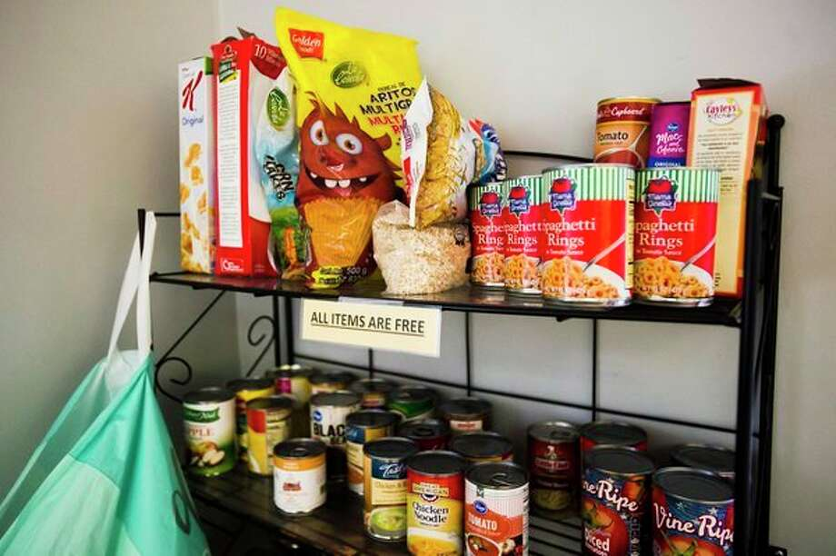 Food items are available for guests to take home for free inside the front office of Shelterhouse Friday, Dec. 6 in Midland. (Katy Kildee/kkildee@mdn.net)