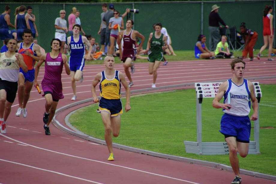 James Bloom looks to pass an opponent in the Stater Open 4x800-meter relay this spring. A captain for Weston before graduating in June, he will be running for the University of Rhode Island next year. Photo: Contributed Photo / Charles Bloom
