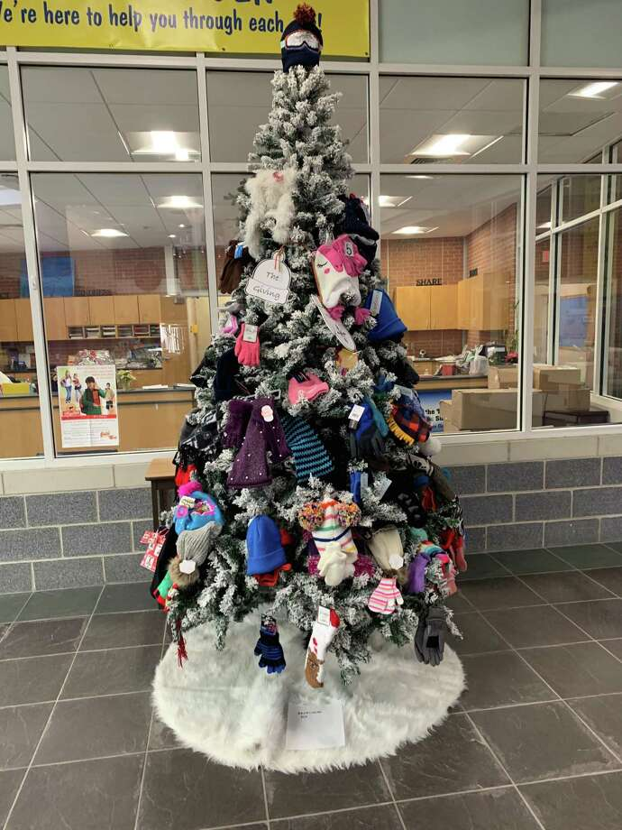 Frenchtown Elementary School's PTA called upon families during the month of December to help families in need by donating new mittens, gloves, hats and/or scarves to keep hands and heads warm this winter. All donations were hung on the Winter Giving Tree at Frenchtown, where two large trees were decorated. The PTA distributed the items on Friday, Dec. 20, to those families. Photo: Contributed Photos