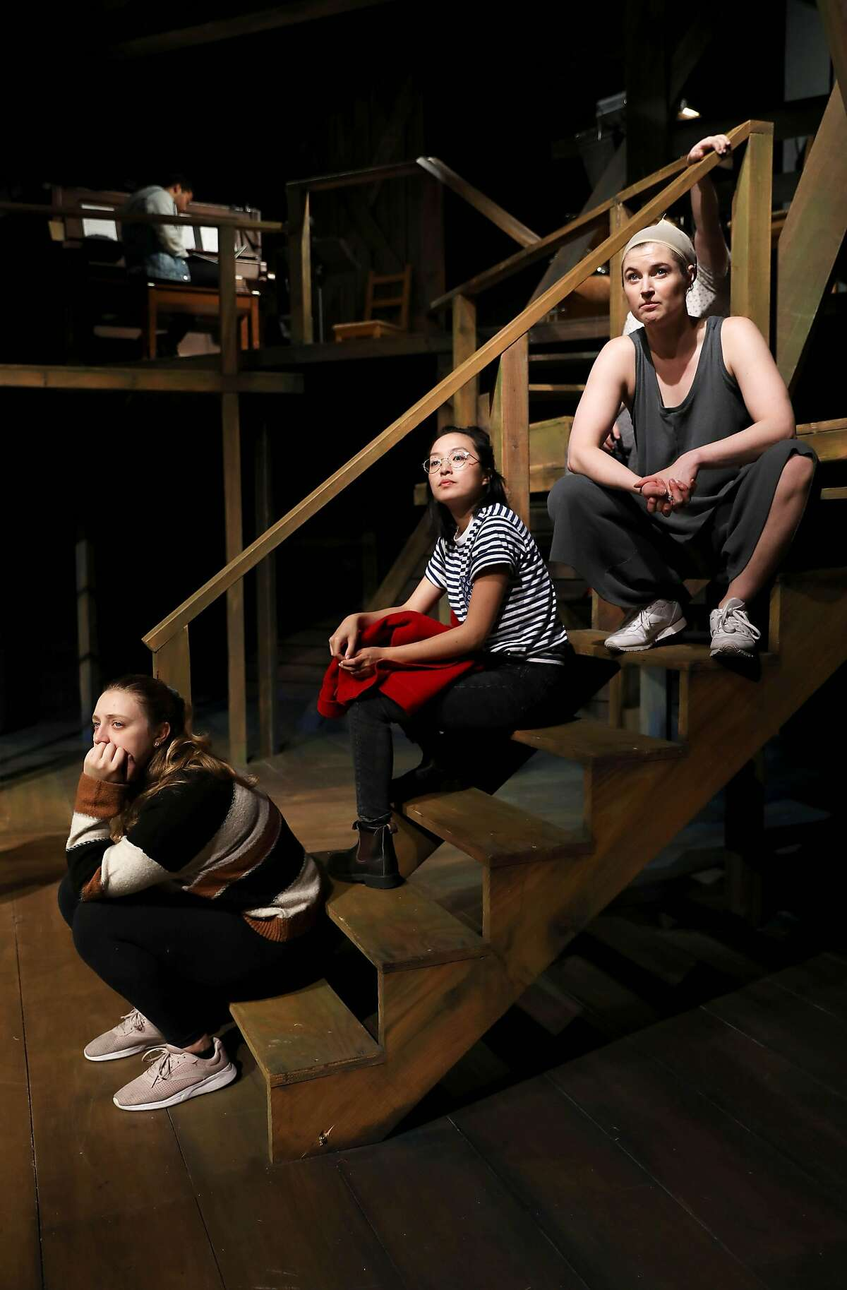 Vinegar Tom cast members Lyndsee Bell, left, Sharon Shao, and Amanda Farbstein listen to instructions during rehearsal at Shotgun Players in Berkeley, Calif., on Wednesday, December 11, 2019. The theater company reclassified actors, stage managers, set building, lighting team as employees a few year ago after a state audit, and is raising money for a fund to cover the extra expenses of doing so.