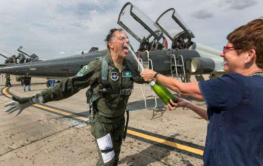 I have covered several so-called fini, or final, flights hosted by the 560th Flying Training Squadron at JBSA-Randolph through the years. But retired Lt. Col. Tom ÒHollywoodÓ HantonÕs flight March 28 was particularly special. He was unusually exuberant receiving his champagne spray after landing, more exuberant than most of the former POWs I have photographed. Talking to him once the excitement subsided I found out his fini flight happened exactly 46 years after his freedom flight out of Hanoi, North Vietnam, March 28, 1973. Photo: William Luther/Staff Photographer