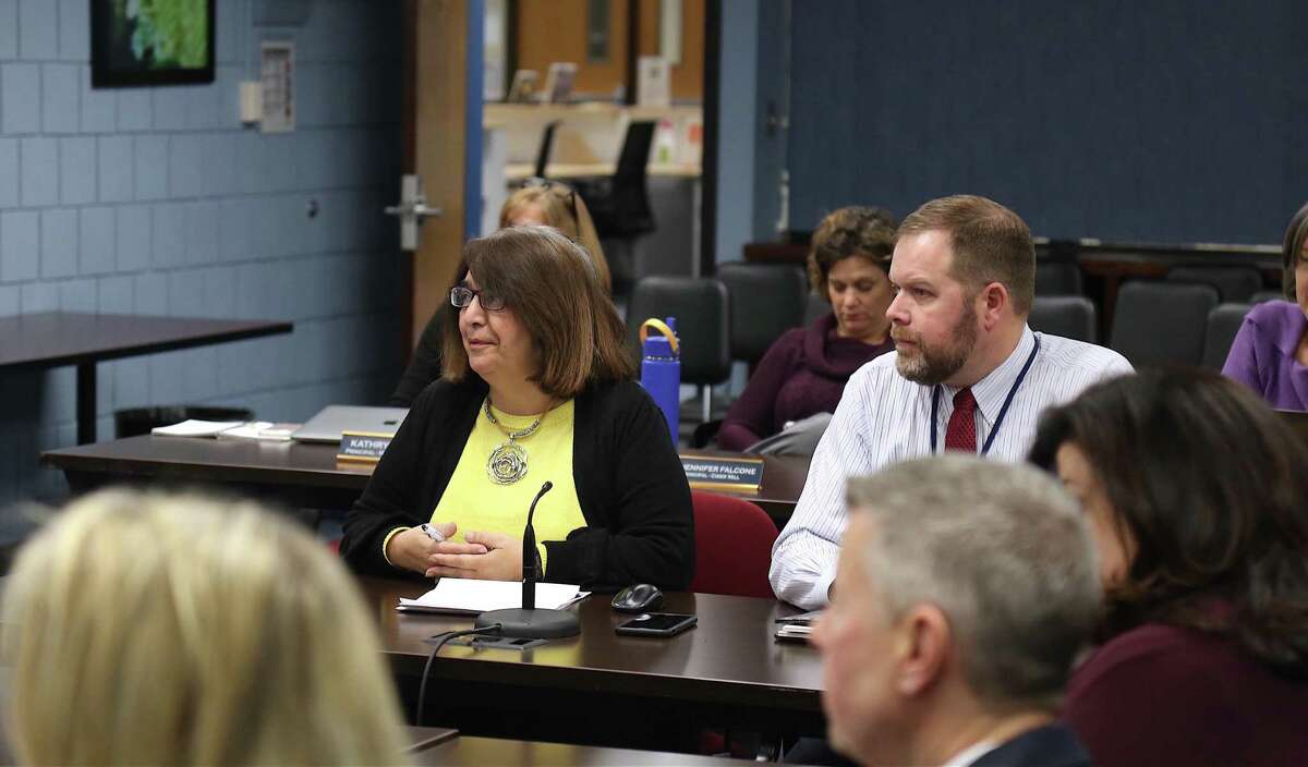 Fran Kompar, director of digital learning, and Erik Haakonsen, director of technology, share an update with the Board of Education Thursday evening, Dec. 19.