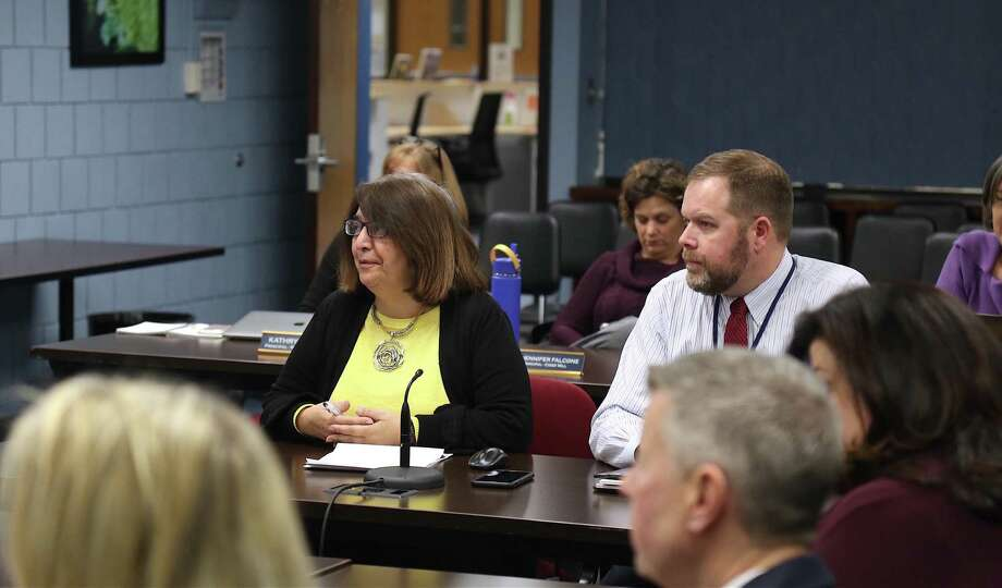 Fran Kompar, director of digital learning, and Erik Haakonsen, director of technology, share an update with the Board of Education Thursday evening, Dec. 19. Photo: Jarret Liotta / Hearst Connecticut Media / Wilton Bulletin