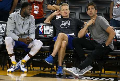 Draymond Green sits on the bench with head coach Steve Kerr and general manager Bob Myers during a Golden State Warriors practice at Oracle Arena in Oakland, Calif. on Wednesday, June 12, 2019 before Thursday's Game 6 of the NBA Finals against the Toronto Raptors.