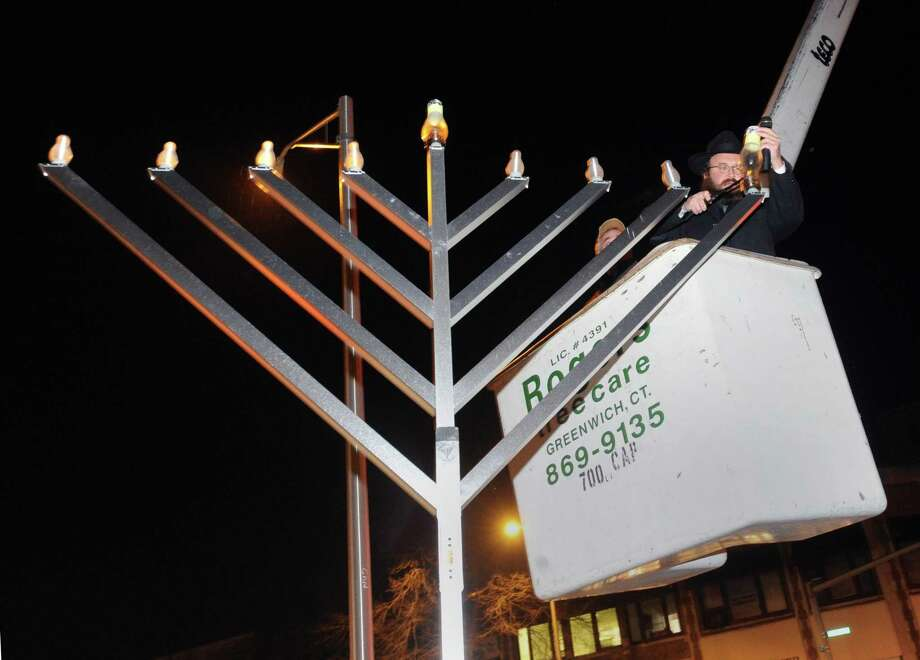 On Sunday, Chabad of Greenwich will host a Hanukkah Wonderland for families, from 11 a.m. to 4 p.m. and a public Menorah lighting at Greenwich Avenue and Arch Street at 4 p.m. This year's Wonderland Party will be held at The Greenwich Art Society at 299 Greenwich Ave., followed by the public Grand Menorah Lighting on a 9-foot-tall Menorah at 4 p.m., followed by music, games, singing, dancing and chocolate coins Gelt for all children. For more details, visit www.chabadgreenwich.org Photo: File / Hearst Media Connecticut / Greenwich Time