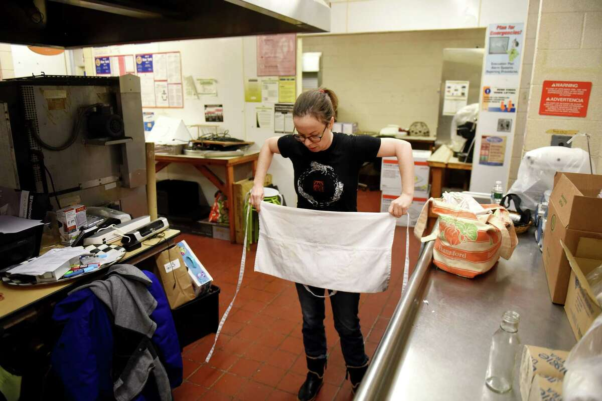 Melanie O'Malley, proprietor of O'Malley's Oven, prepares for work at her bakery on Tuesday, Dec. 17, 2019, in Schodack, N.Y. O'Malley, who was affected by the fallout of MyPayrollHR, has been at the forefront of efforts from local Capital Region business owners to push for a legislative fix to the payroll industry. (Will Waldron/Times Union)