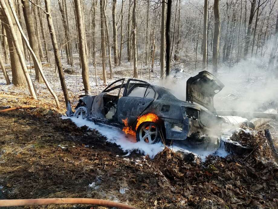 Flames come of this vehicle that caught fire on Rosebrook Road in New Canaan, Connecticut, Thursday morning, Dec. 19, 2019, with the driver's life saved. Photo: New Canaan Fire Department / Contributed Photo