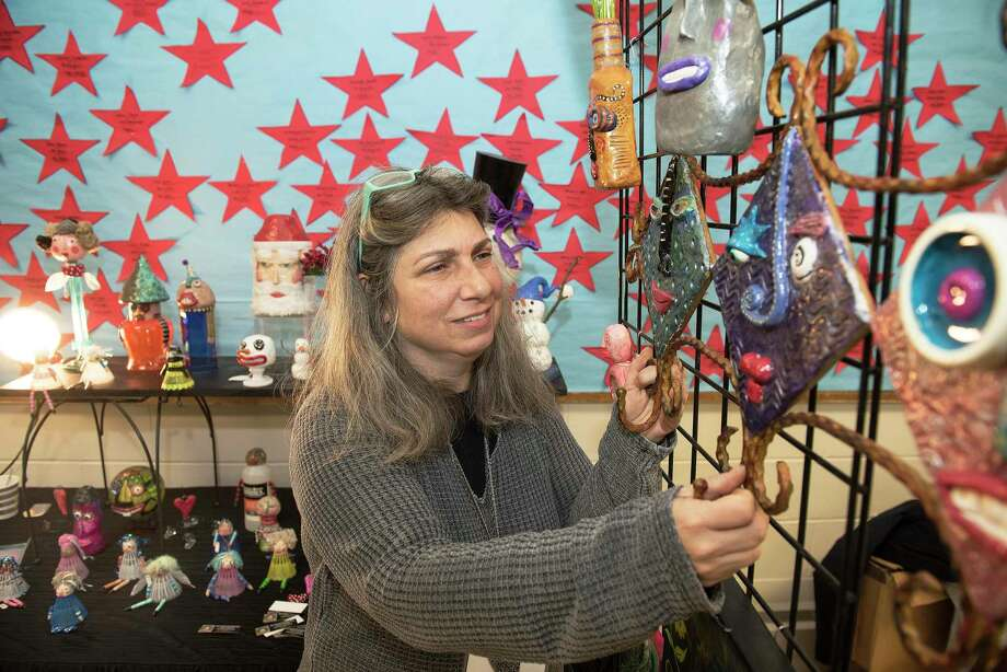 Jodi Oster of Oster Folk Art sold crafts from recycled and reclaimed items at The Ridgefield Woman's Club Craft Fair on Saturday 23, November 2019 in Ridgefield, Conn. Jodi Oster of Oster Folk Art sold crafts from recycled and reclaimed items at The Ridgefield Woman's Club Craft Fair on Saturday 23, November 2019 in Ridgefield, Conn. Photo: Bryan Haeffele / Hearst Connecticut Media / Hearst Connecticut Media