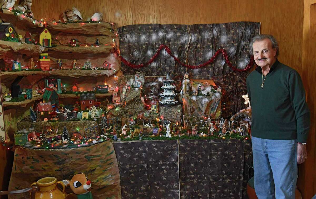 Oswaldo Riccio stands next to a large nativity scene in his home he built to honor his deceased wife Pupa on Friday, Dec. 20, 2019 in Albany, N.Y. (Lori Van Buren/Times Union)