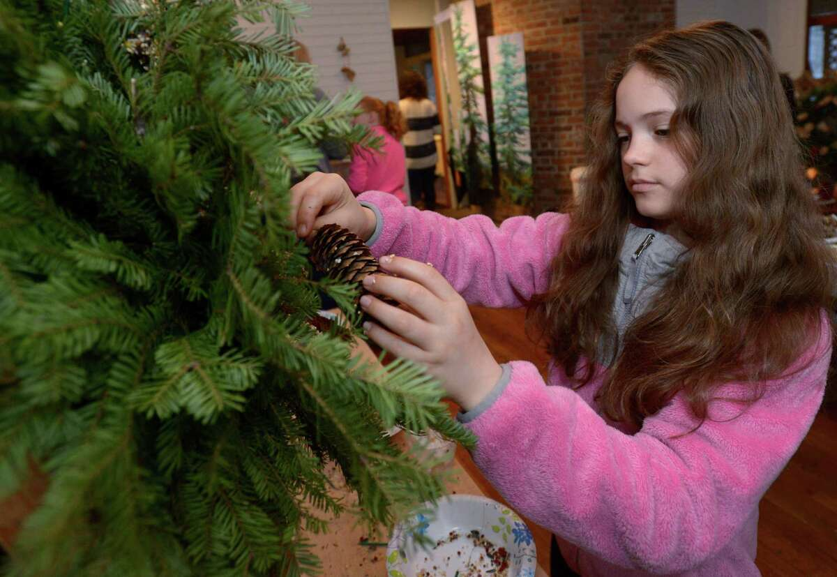 Wilton resident Abby Jones decorates her wreath during last year's Wreaths for Wildlife Fundraiser at the Woodcock Nature Center. This year's program is on Friday, Jan. 3.