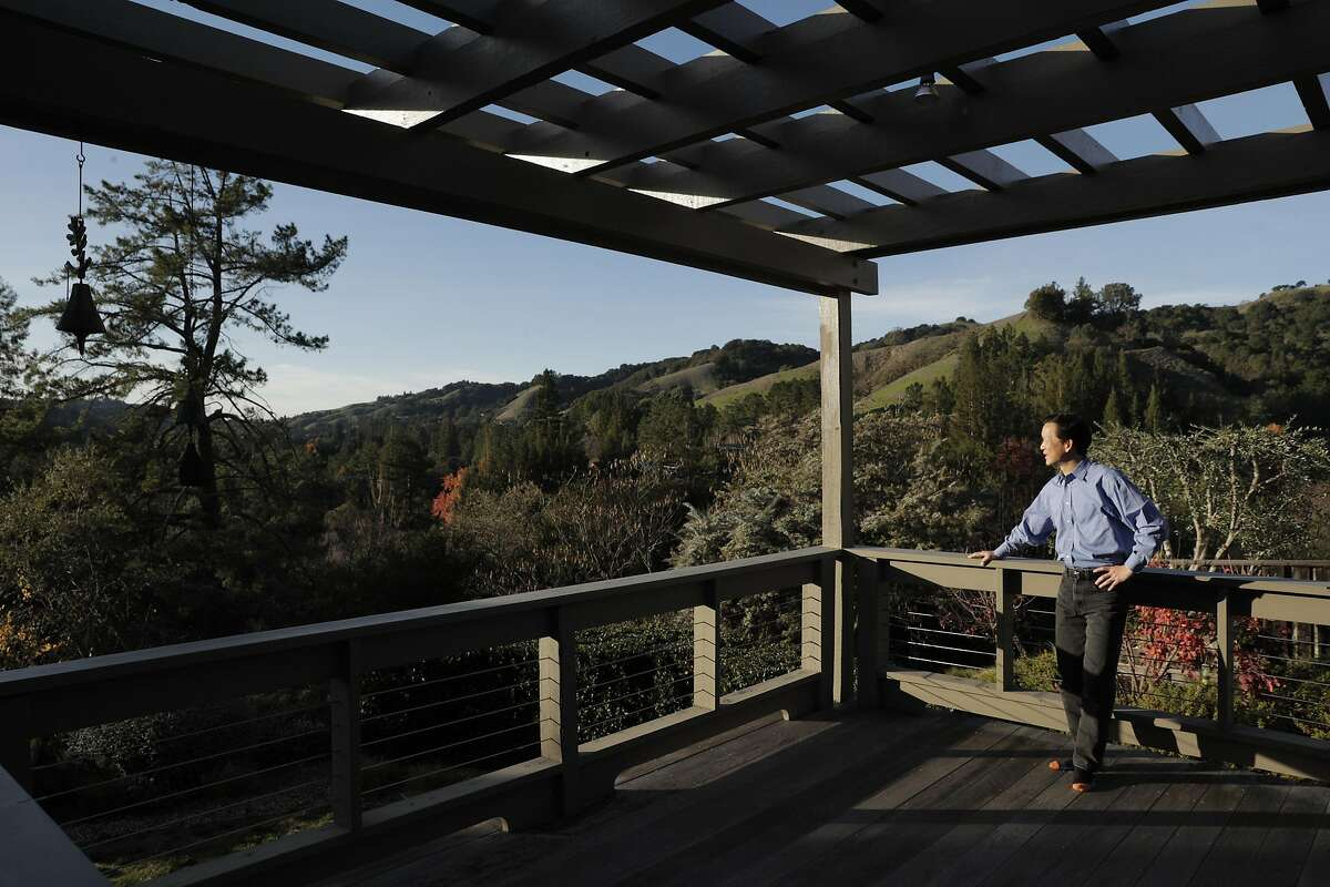 Wei-Tai Kwok at his home that he completely converted to electric to stop using natural gas in Lafayette, Calif., on Monday, December 16, 2019. In January, new state requirements requiring rooftop solar panels on new homes will go into effect. At the same time, many municipalities are banning gas appliances inside residences and commercial buildings, pushing all-electric construction.