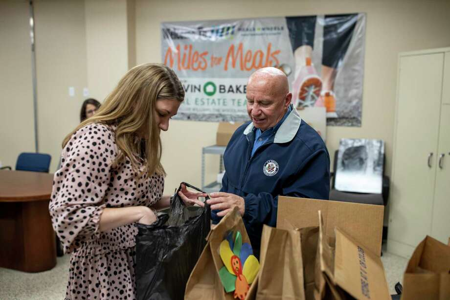 U.S. Rep. Kevin Brady (R-TX) and Executive Director of the Meals on Wheels Program in Montgomery County, Summer Day, sort through boxes and bags of prepared meals on Monday, Dec. 2, 2019. Photo: Gustavo Huerta, The Courier / Staff Photographer / © 2019 Gustavo Huerta / The Courier