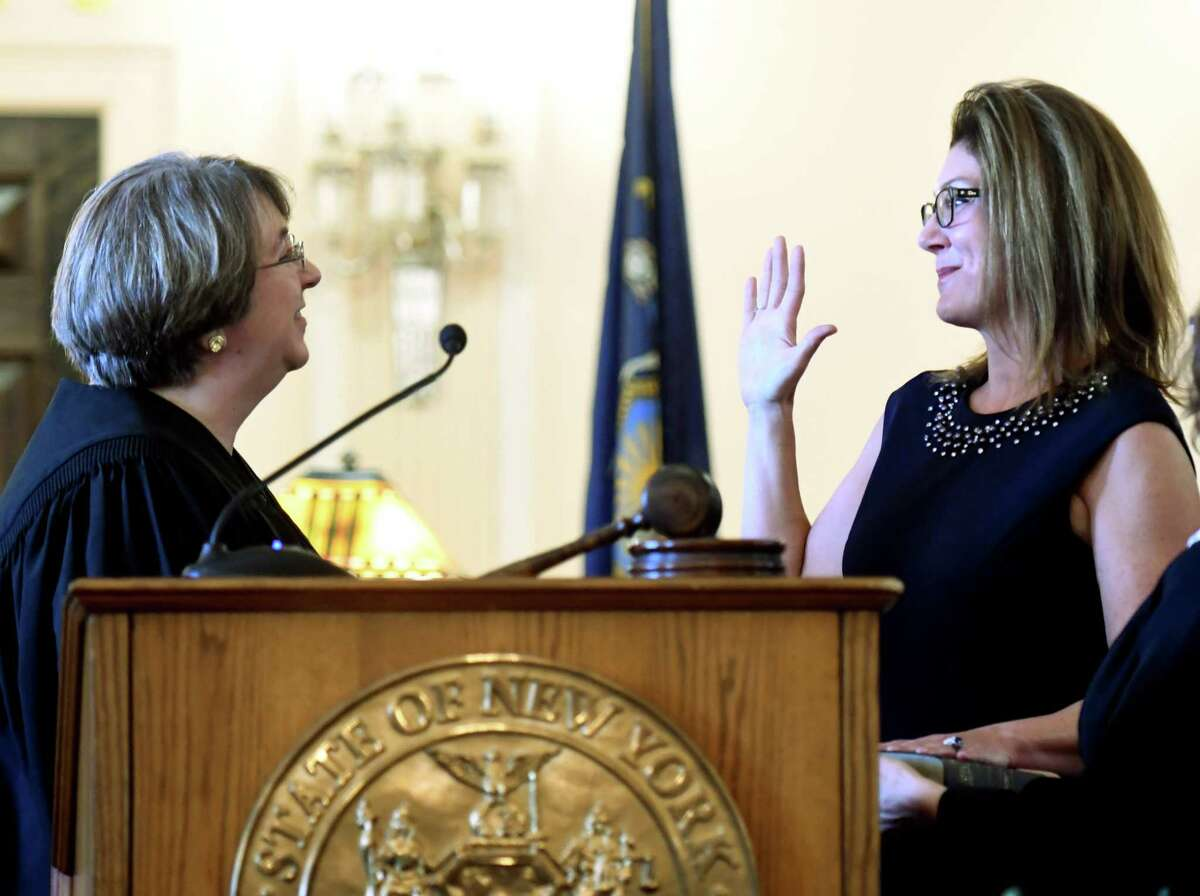 Andra Ackerman, right, is sworn in as an Albany County Court Judge by the Hon. Elizabeth A. Garry, left, during a ceremony on Friday, Dec. 20, 2019, at the Albany County Courthouse in Albany, N.Y. Ackerman, who served as a Cohoes City Court judge, made history by being the first woman elected to the position. (Will Waldron/Times Union)