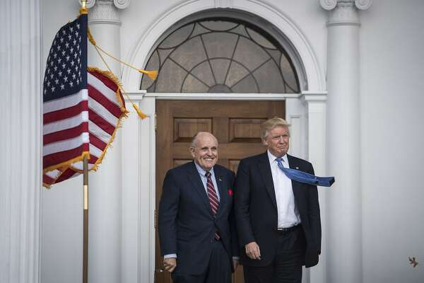 BEDMINSTER TOWNSHIP, NJ - NOVEMBER 20: President-elect Donald Trump greets Rudy Giuliani at the clubhouse at Trump National Golf Club Bedminster in Bedminster Township, N.J. on Sunday, Nov. 20, 2016. (Photo by Jabin Botsford/The Washington Post via Getty Images)