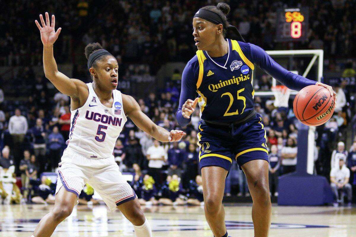 Crystal Dangerfield guards Quinnipiac's Aryn McClure in UConn's 71-46 victory in the 2018 NCAA Tournament Second Round.