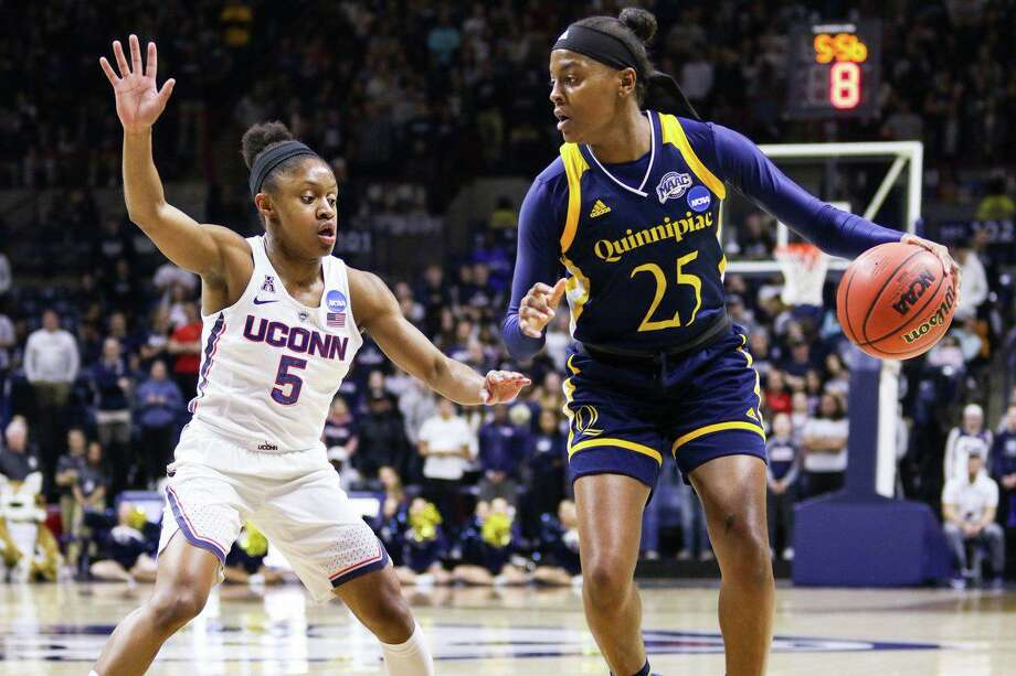 Crystal Dangerfield guards Quinnipiac's Aryn McClure in UConn's 71-46 victory in the 2018 NCAA Tournament Second Round. Photo: Morgan Tencza / For Hearst Connecticut Media