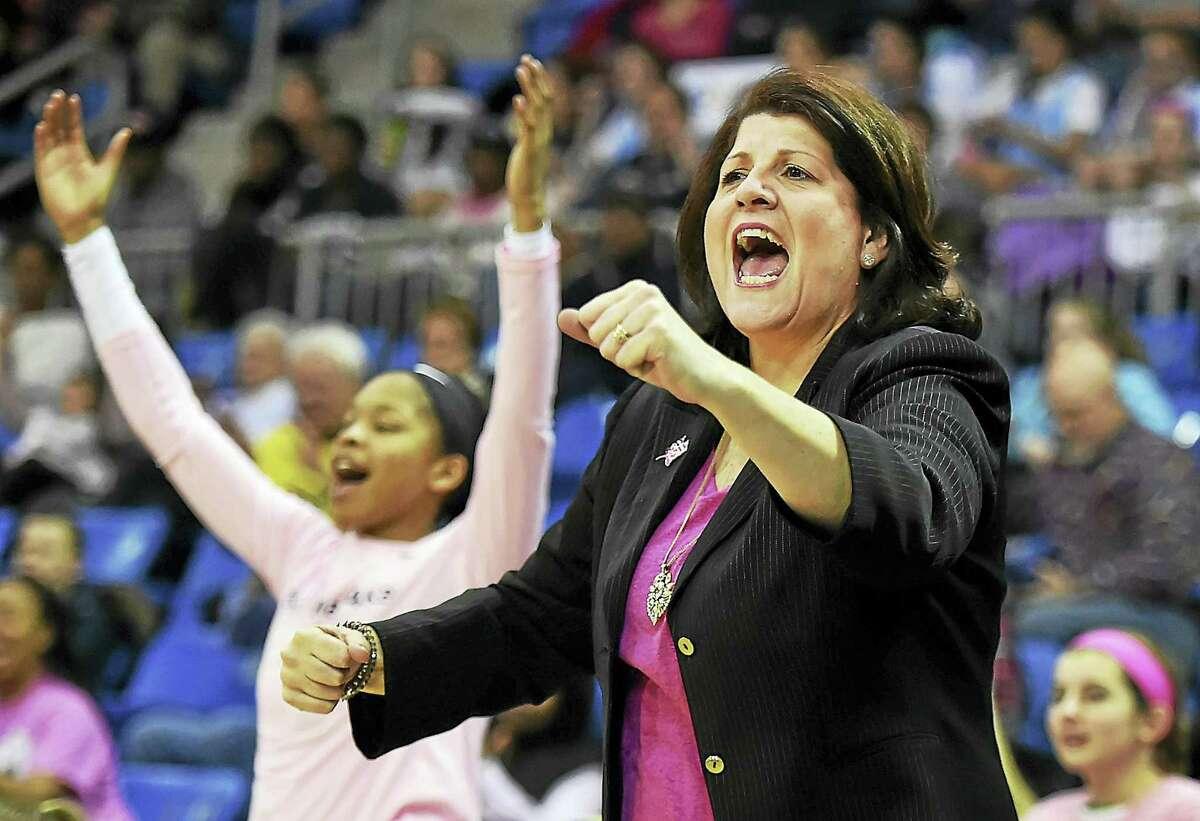 Quinnipiac head coach Tricia Fabbri celebrates on the sideline as the Bobcats defeated Iona, 53-45, in 2017.