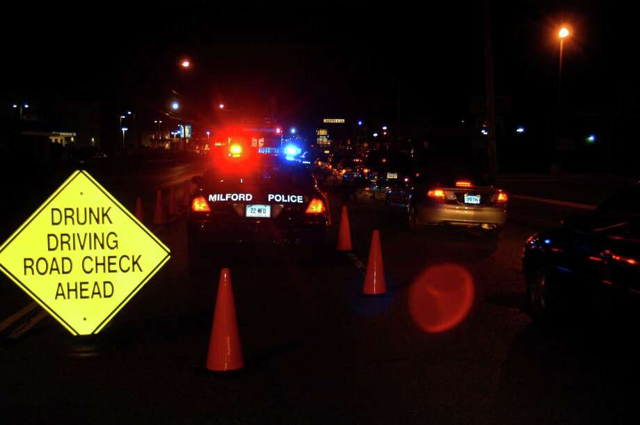 File photo of a DUI checkpoint by Milford police. Photo: Hearst Connecticut Media File Photo